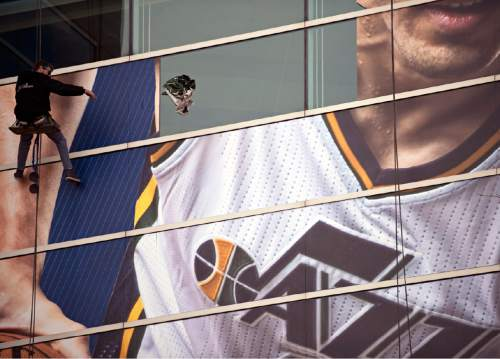 Lennie Mahler  |  The Salt Lake Tribune  Window workers remove the banner of former Jazz center Enes Kanter from EnergySolutions Arena on Friday following his Thursday trade to the Oklahoma City Thunder. The Turkish big man was drafted No. 3 by the Jazz in the 2011 NBA Draft.