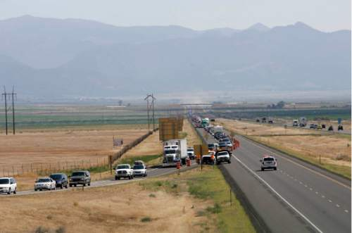Northbound 1-15 traffic is backed up for miles July 8, 2007, near Beaver, Utah, due to the Milford Flat wildfire.   Rick Egan/The Salt Lake Tribune