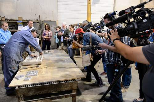 Trent Nelson  |  The Salt Lake Tribune Howard Bailey demonstrates the creation of a mold, part of the process of recasting pieces of the U.S. Capitol Dome's cast iron ornamentation that cannot be repaired for replacement on the Capitol, at Historical Arts & Casting in West Jordan, Tuesday March 31, 2015.