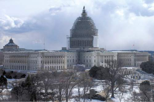 Scaffolding surrounds the U.S. Capitol Dome in this image from January 2015. Architect of the Capitol is overseeing the first full restoration of the iconic structures since 1959-60.