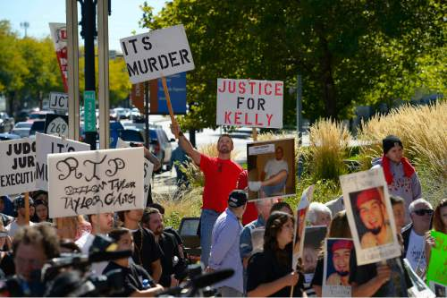 Leah Hogsten  |  The Salt Lake Tribune Over a dozen families whose families have been killed or shot by police filled the crowd at the Families Speak Out On Police Violence rally Saturday, October 4, 2014, at the Matheson Courthouse.
