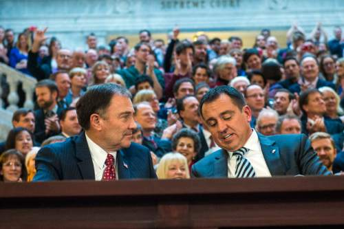 Chris Detrick  |  The Salt Lake Tribune Gov. Gary Herbert and House Speaker Greg Hughes sign SB296 at the Utah State Capitol Thursday March 12, 2015.