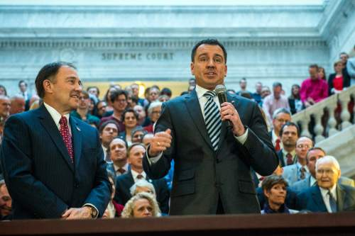 Chris Detrick  |  The Salt Lake Tribune Gov. Gary Herbert listens as House Speaker Greg Hughes speaks about SB296 at the Utah State Capitol Thursday March 12, 2015.