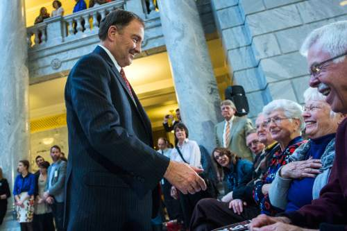 Chris Detrick  |  The Salt Lake Tribune Gov. Gary Herbert shakes hands with Gary and Millie Watts during the ceremony to sign SB296 at the Utah State Capitol Thursday March 12, 2015.