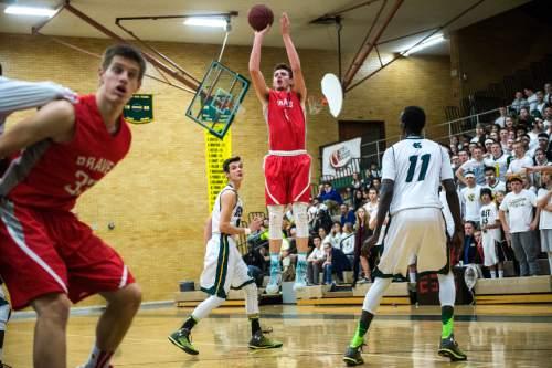 Chris Detrick  |  The Salt Lake Tribune Bountiful's Zac Seljaas (1) shoots past Kearns' Tayler Marteliz (10) and Kearns' Buay Kuajian (11) during the game at Kearns High School Friday January 30, 2015.