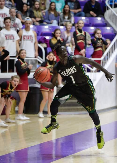 Francisco Kjolseth  |  The Salt Lake Tribune  Kearns's Bushmen Ebet (1) keeps a ball in play over Logan in 4A boys' hoops quarterfinal at the Dee Events Center in Ogden on Thursday, Feb. 26, 2015.
