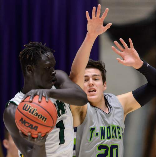 Trent Nelson  |  The Salt Lake Tribune Kearns's Bushmen Ebet (1), defended by Timpanogos's Arthur Coombs IV as Kearns faces Timpanogos High School in the state 4A boys basketball tournament at the Dee Events Center in Ogden, Tuesday February 24, 2015.