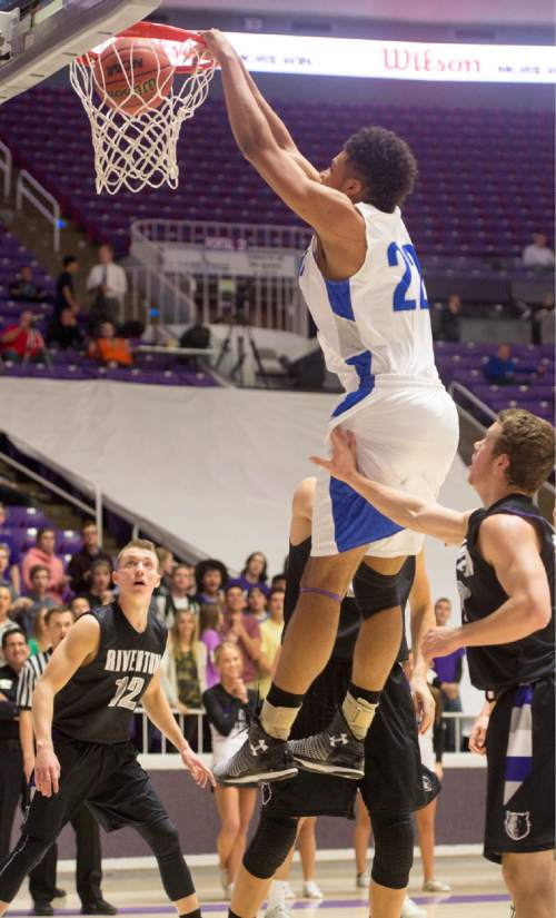 Rick Egan  |  The Salt Lake Tribune  Bingham forward Yoeli Childs (22) dunks the ball, in 5A Boys Basketball State Tournament action, Bingham vs Riverton, at the Dee Event Center, Monday, February 23, 2015