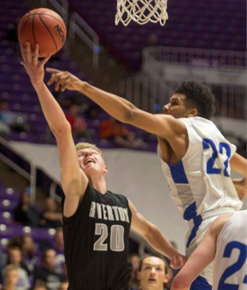 Rick Egan  |  The Salt Lake Tribune  Riverton guard Joseph Andrews (20) gets by Bingham forward Yoeli Childs (22) for two points, in 5A Boys Basketball State Tournament action, Bingham vs Riverton, at the Dee Event Center, Monday, February 23, 2015