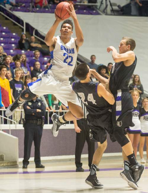 Rick Egan  |  The Salt Lake Tribune  Bingham forward Yoeli Childs (22) fakes out the defense and takes a open shot for the Miners, in 5A Boys Basketball State Tournament action, Bingham vs Riverton, at the Dee Event Center, Monday, February 23, 2015