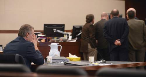 Al Hartmann  |  The Salt Lake Tribune  Douglas Anderson Lovell sits by himself at the defense table as Judge Michael D. DiReda calls lawyers to his bench during closing arguments in Ogden Tuesday March 31, 2015. Prosecutors asked for the death penalty for Lovell. Lovell, 57, has been convicted of aggravated murder for kidnapping and killing 39-year-old Joyce Yost in 1985 to keep her from testifying against him in a rape case.