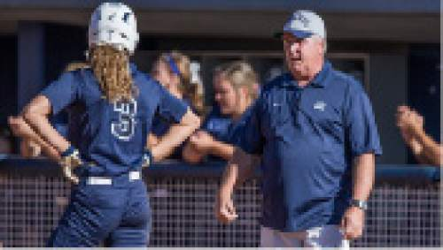 Jaren Wilkey  |  BYU Photo.  Coach Eakin talking with No. 3 Ashley Thompson during their game one March 20, 2015 against Oklahoma State.
