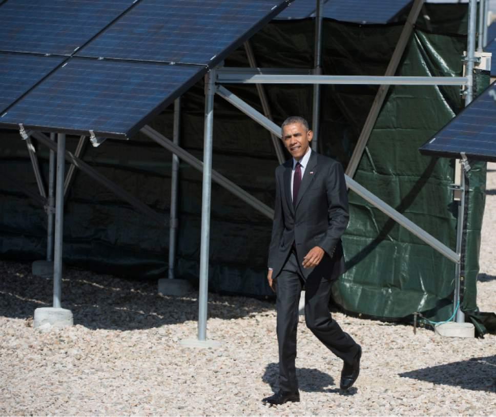 Steve Griffin  |  The Salt Lake Tribune  President Barack Obama arrives in front of solar panels at Hill Air Force Base in Ogden, Friday, April 3, 2015.
