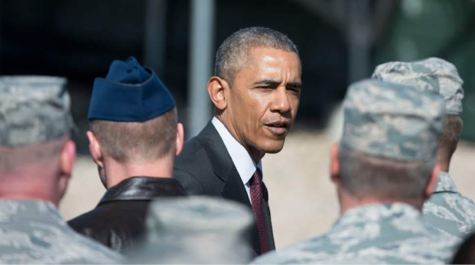Steve Griffin  |  The Salt Lake Tribune  President Barack Obama talks with Air Force base personnel after he delivered a speech in front of solar panels at Hill Air Force Base  in Ogden, Friday, April 3, 2015.