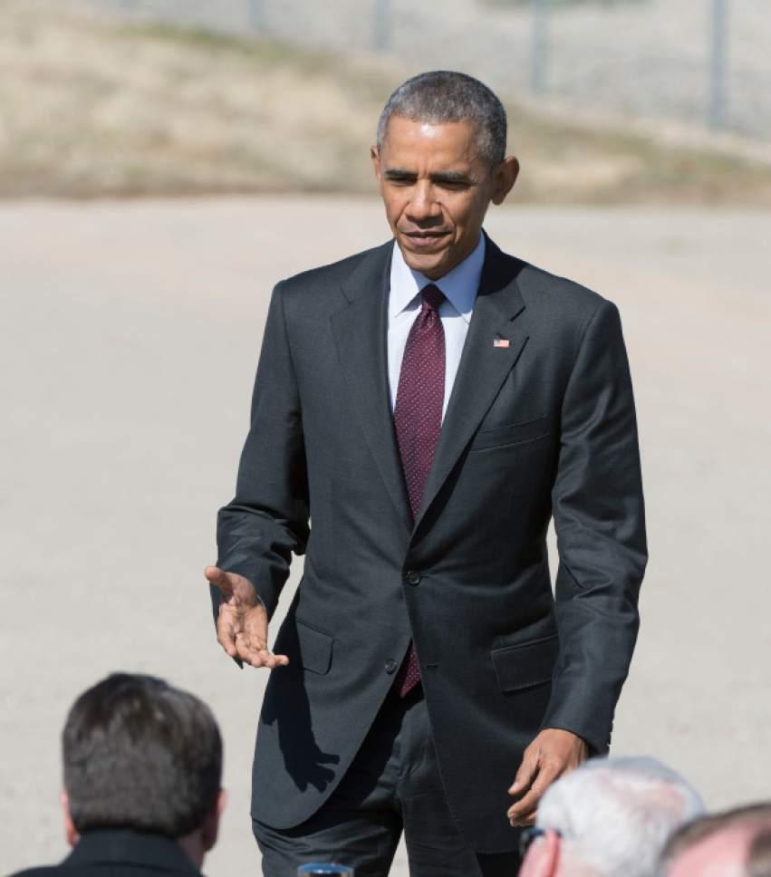 Steve Griffin  |  The Salt Lake Tribune  President Barack Obama delivers a speech in front of solar panels at Hill Air Force Base  in Ogden, Friday, April 3, 2015.