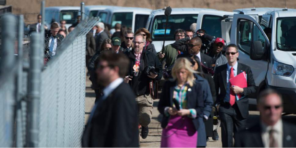 Steve Griffin  |  The Salt Lake Tribune  Traveling media pool members to catch up with President Barack Obama as he arrives at a solar panel field at Hill Air Force Base where he delivered a speech in Ogden, Friday, April 3, 2015.