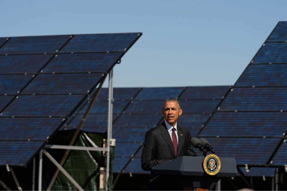 Trent Nelson  |  The Salt Lake Tribune Standing in front of an array of solar panels, President Barack Obama announces a series of solar power initiatives at Hill Air Force Base, Friday April 3, 2015.