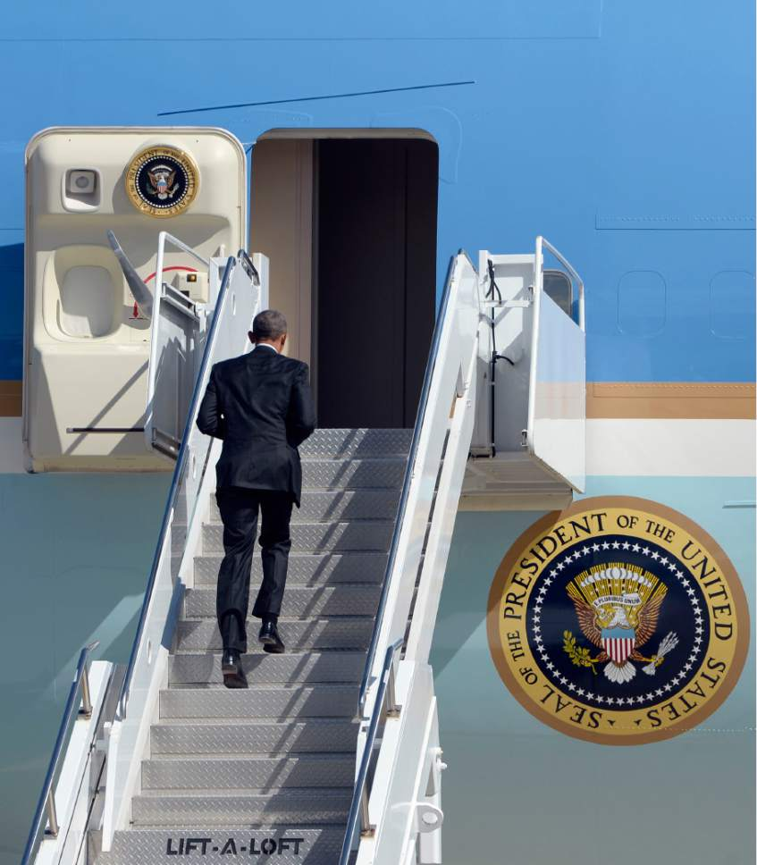 Al Hartmann  |  The Salt Lake Tribune  President Barack Obama jogs up stairs of Air Force One to depart from Hill Air Force Base at 11:20 a.m. Friday April 3.