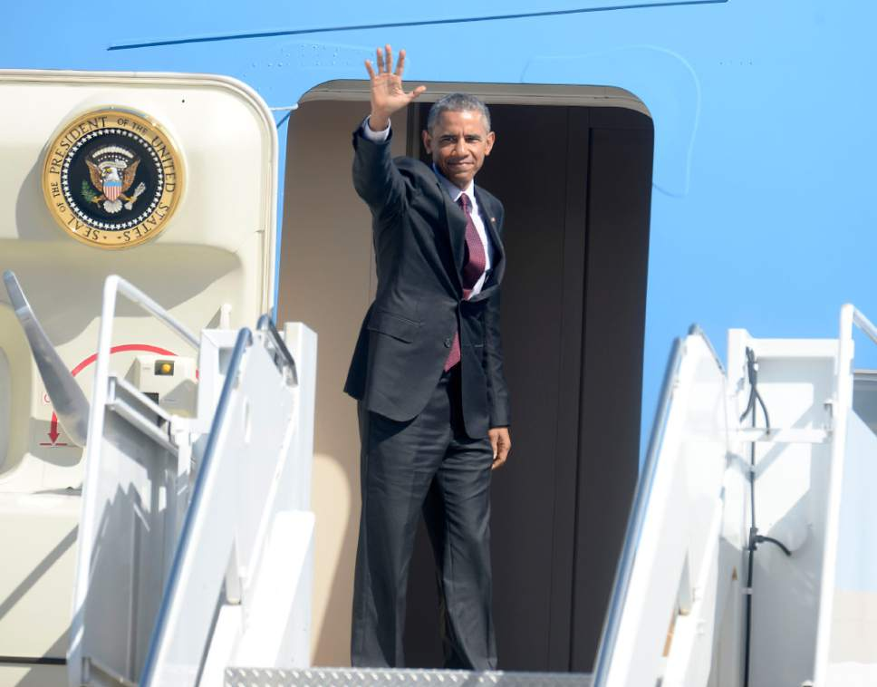 Al Hartmann  |  The Salt Lake Tribune  President Barack Obama gives a last wave from stairs of Air Force One before departing from Hill Air Force Base at 11:20 a.m. Friday April 3.
