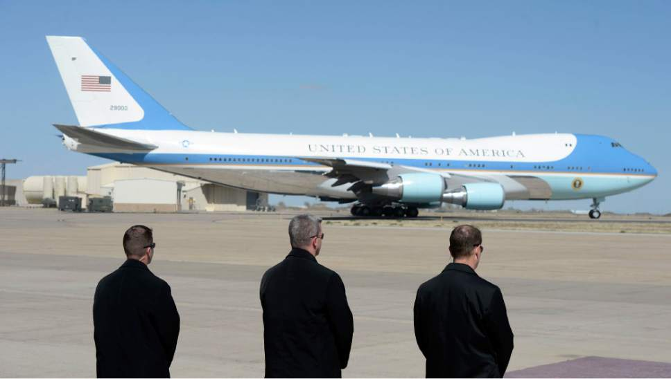 Al Hartmann  |  The Salt Lake Tribune  Secret Service members watch as President Barack Obama leaves aboard Air Force One from Hill Air Force Base at 11:20 a.m. Friday April 3.
