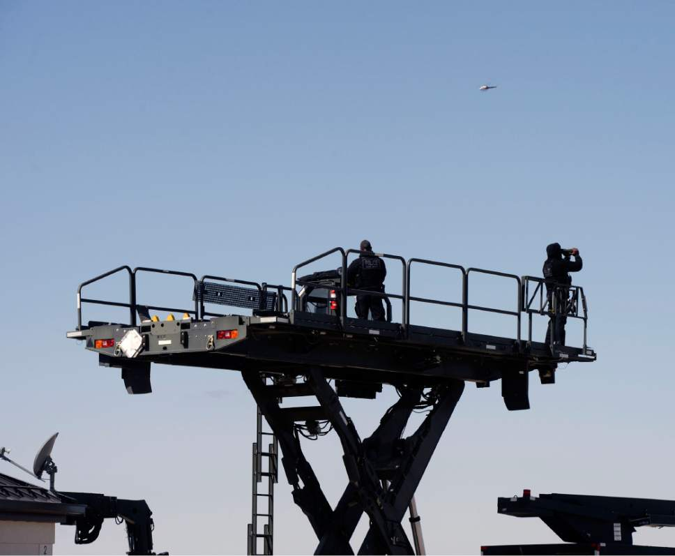 Al Hartmann  |  The Salt Lake Tribune  Security watches from eleveated platform as President Barack Obama leaves aboard Air Force One from Hill Air Force Base at 11:20 a.m. Friday April 3.