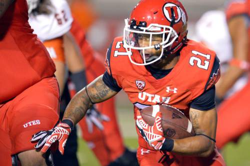 Chris Detrick  |  The Salt Lake Tribune Utah Utes running back Troy McCormick (21) runs the ball during the second half of the game at Rice-Eccles stadium Thursday August 28, 2014. Utah defeated Idaho State 56-14.