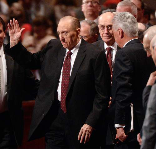 Al Hartmann  |  The Salt Lake Tribune  President Thomas S. Monson, left, waves to the crowd at the conclusion of the 185th LDS General Conference on Sunday April 5, 2015. Right: First Counselor Henry B. Eyring and Second Counselor Dieter F. Uchtdorf.