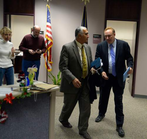 Keith Johnson | The Salt Lake Tribune  Utah Sen. Jim Dabakis (right) and Salt Lake District Attorney Sim Gill leave the Salt Lake County clerks office, Friday, December 20, 2013. Sen. Dabakis was trying to keep the clerks office open late Friday to accommodate more same sex couples seeking marriage licenses. A federal judge in Utah Friday struck down the state's ban on same-sex marriage, saying the law violates the U.S. Constitution's guarantees of equal protection and due process.