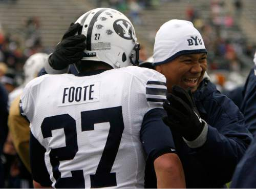 Trent Nelson  |  The Salt Lake Tribune Mark Atuaia celebrates with BYU running back David Foote (27) after his fourth quarter touchdown, BYU vs. Colorado State, college football, Saturday, November 13, 2010. BYU won 49-10.