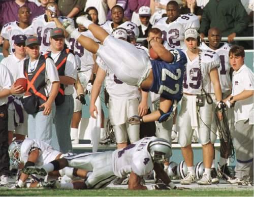Rick Egan | Tribune file photo   Mark Atuaia takes a tumble as KSU's Mario Smith lays on the ground.
