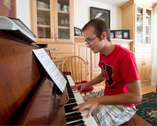 Steve Griffin  |  The Salt Lake Tribune  Grayson Moore, who is transgender, practices the piano in his Syracuse, Utah home Thursday, March 19, 2015.