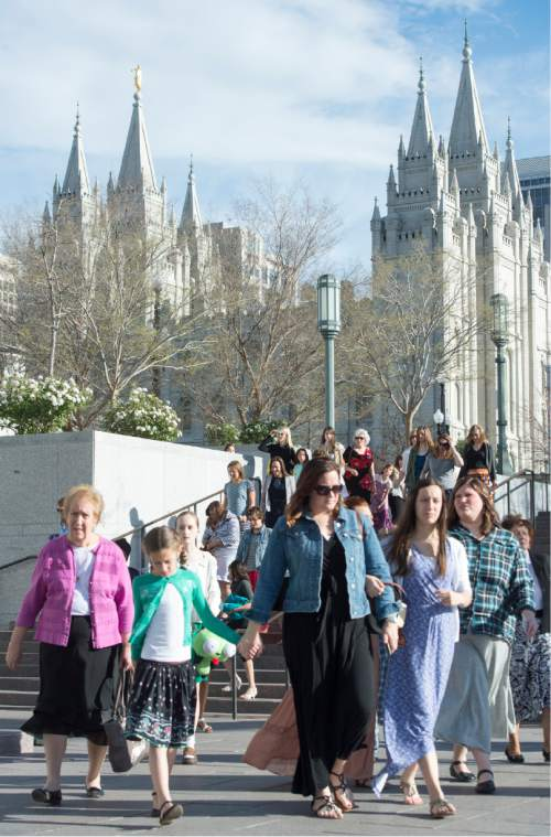 Rick Egan  |  The Salt Lake Tribune Women walk on Saturday to the conference center for the first session of the 185th LDS General Conference, designated as the General Women's Meeting, attended by all LDS females 8-years-old and older.
