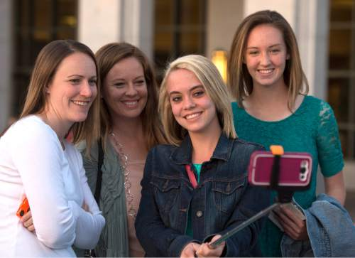 Rick Egan  |  The Salt Lake Tribune  Left to Right  - Jolene Walker, Pheera Kidd, Kylene Walker, and Morgan Kidd, from Grand Junction Colorado, take a selfie in front of the LDS Conference Center, after the General Women's Meeting, Saturday, March 28, 2015.