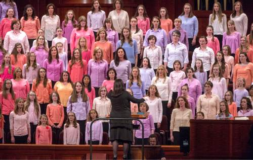 Rick Egan  |  The Salt Lake Tribune  Erin Tall directs a combined Primary, Young Women, and Relief Society Choir from stakes in Salt Lake City, Murray, Kamas and Park City, at the first session of the 185th LDS General Conference, designated as the General Women's Meeting, attended by all LDS females 8-years-old and older, Saturday, March 28, 2015.