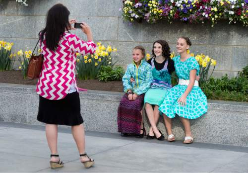 Rick Egan  |  The Salt Lake Tribune  Tammy Blaisdell takes photos of Izzy Blaisell, Alex Blaisdell, Abbey Nelson, Syracuse, pause to take photo on Temple Square, on their way to the LDS conference center for the first session of the 185th LDS General Conference, designated as the General Women's Meeting, attended by all LDS females 8-years-old and older, Saturday, March 28, 2015.