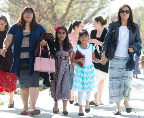 Rick Egan  |  The Salt Lake Tribune  Nelly Berdomo, and Romina Berdomo, from Urugya, and Samantha and Diana Angulo, from Mexico, walk to the LDS conference center for the first session of the 185th LDS General Conference, designated as the General Women's Meeting, attended by all LDS females 8-years-old and older, Saturday, March 28, 2015.