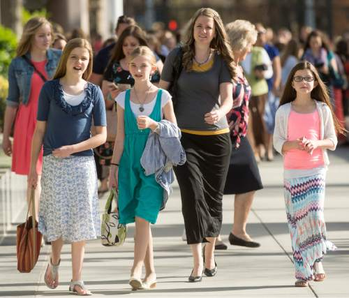 Rick Egan  |  The Salt Lake Tribune  Women walk to the conference center for the first session of the 185th LDS General Conference, designated as the General Women's Meeting, attended by all LDS females 8-years-old and older, Saturday, March 28, 2015.