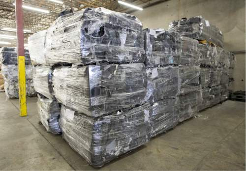 Rick Egan  |  The Salt Lake Tribune  Plastic parts from computer monitors are stacked at Metech Recycling, in Salt Lake City, where they are recycled properly, Friday, March 20, 2015.