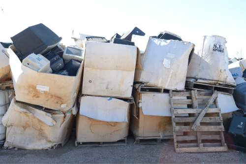 Rick Egan  |  The Salt Lake Tribune  Boxes of glass from television sets and computer monitors sit outside the Stone Castle warehouse in Clearfield, Friday, March 20, 2015.