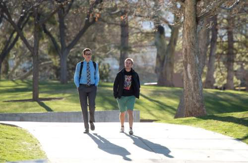 Rick Egan  |  The Salt Lake Tribune University of Utah students, Ryan Clayton and Sam Babcock walk to class last month. University officials faces student questions on tuition, faculty raises and other issues on Tuesday.