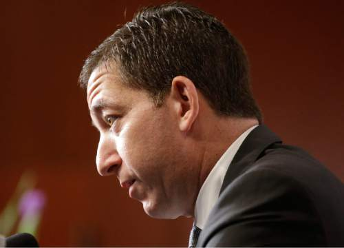Lawyer and journalist Glenn Greenwald speaks with members of the media Tuesday, April 7, 2015, in Salt Lake City. Greenwald, the man who used top-secret documents leaked by Edward Snowden to write about global surveillance programs for a British newspaper, will speak with students at the University of Utah Tuesday evening. (AP Photo/Rick Bowmer)