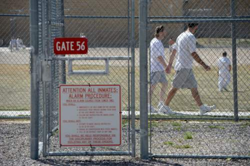 Al Hartmann  |  The Salt Lake Tribune  Inmates walk in the excercise field at the Central Utah Correctional Facility in Gunnison Monday March 23, 2015.