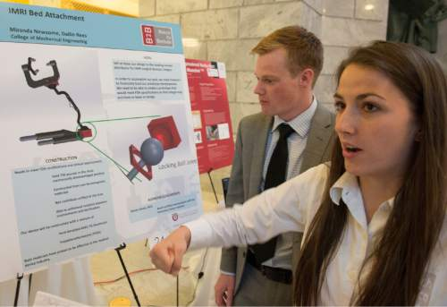Rick Egan  |  The Salt Lake Tribune  Dallin Rees and Miranda Newsome demonstrate the IMRI Bed Attachment they developed, as University of Utah students showcased a variety of inventions during the fifth annual Bench-2-Bedside (B2B) competition at the Utah State Capitol Rotunda, Wednesday, April 8, 2015.