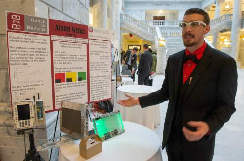 Rick Egan  |  The Salt Lake Tribune  John Platt talks about the alarm he developed to help reduce the noise in hospital rooms as University of Utah students showcased a variety of inventions during the fifth annual Bench-2-Bedside (B2B) competition at the Utah State Capitol Rotunda, Wednesday, April 8, 2015.