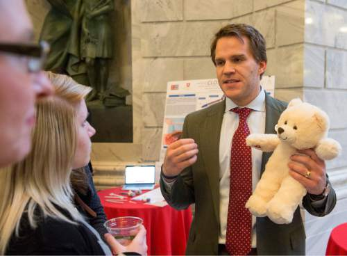 "Rick Egan  |  The Salt Lake Tribune  Bryan Jensen talks about the benefits of the ""Teddy Care"" teddy  bear, as University of Utah students showcased a variety of inventions during the fifth annual Bench-2-Bedside (B2B) competition at the Utah State Capitol Rotunda, Wednesday, April 8, 2015."