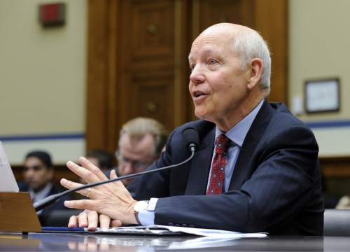 FILE - In this July 23, 2014 file photo, IRS Commissioner John Koskinen testifies on Capitol Hill in Washington. The IRS is cutting taxpayer services to historically low levels just as President Barack Obama's health law will make filing a federal tax return more complicated for millions of families. (AP Photo, File)
