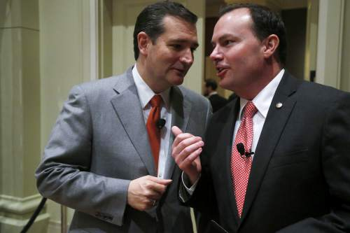 """Sen. Ted Cruz, R-Texas, left, has a word with Sen. Mike Lee, R-Utah, after Cruz spoke at the Susan B. Anthony List """"Campaign for Life Gala and Summit"""", a gathering of anti-abortion advocates, in Washington, Wednesday, March 12, 2014. Looking to aid political candidates who share their views, anti-abortion activists are auditioning potential 2016 presidential contenders. Like many evangelicals, the Susan B. Anthony List is in search of an anti-abortion crusader who has a shot at winning the Republican nomination in 2016 after back-to-back presidential nominees that left the socially conservative wing of the GOP ambivalent at best.(AP Photo/Charles Dharapak)"""
