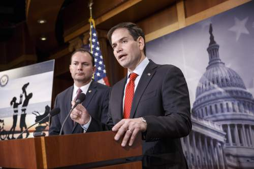 Sen. Marco Rubio, R-Fla., right, accompanied by Sen. Mike Lee, R-Utah, outline their ideas for a new tax plan during a news conference on Capitol Hill in Washington, Wednesday, March 4, 2015.  (AP Photo/J. Scott Applewhite)