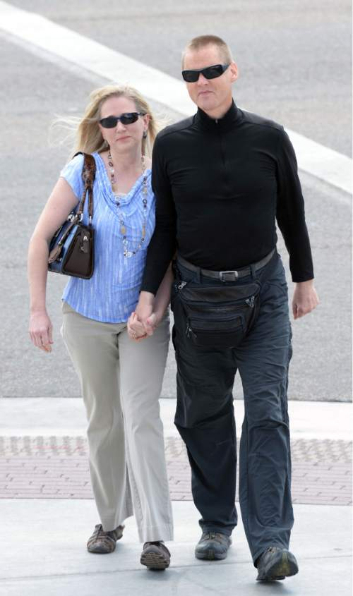 Steve Griffin  |  The Salt Lake Tribune  Dell Schanze, and his wife Teresa, walk into the Federal Courthouse in Salt Lake City, Thursday, April 9, 2015 where he is expected to plead guilty in his owl kicking case.