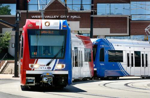 Scott Sommerdorf  |  The Salt Lake Tribune A TRAX train passes by the West Valley City Hall as it leaves the West Valley Central Station 2750 W. 3590 South, Sunday, August 7, 2011. The new TRAX lines, West Valley and the Mid-Jordan/University line opened Sunday.